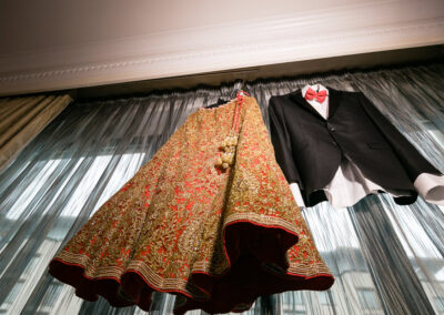 Bride and Groom red lengha and black two piece suit .